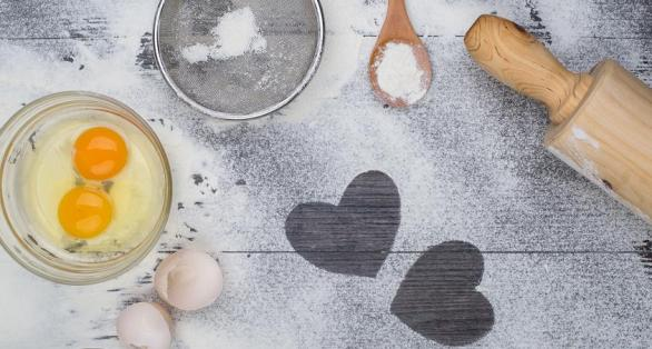 heart of flour on wooden desk